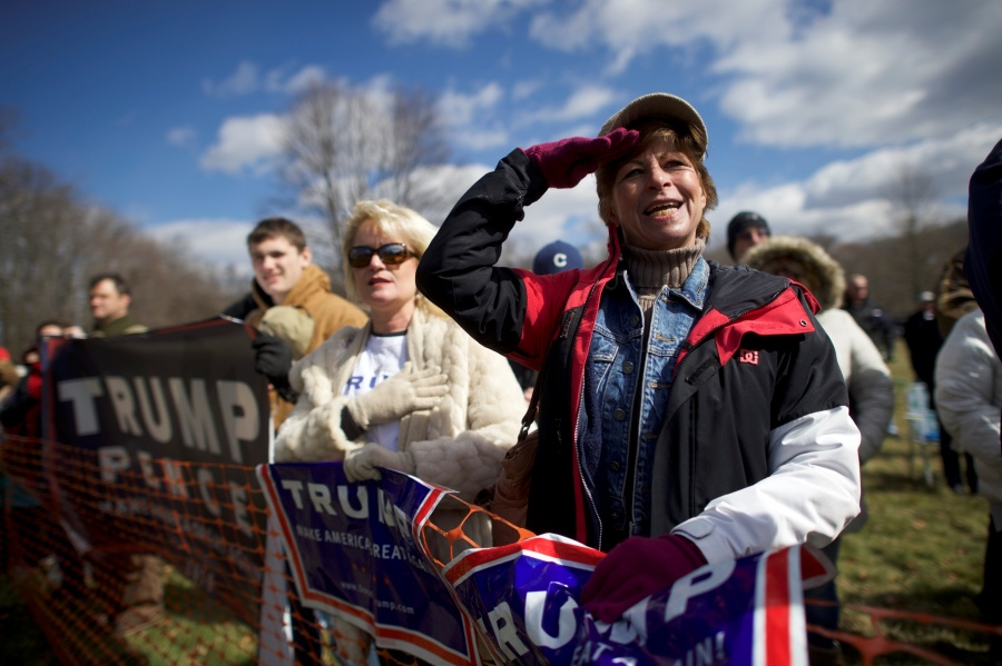 "Donald Trump supporter Beth Holz salutes during a ""People 4 Trump"" rally at Neshaminy State Park in Bensalem"