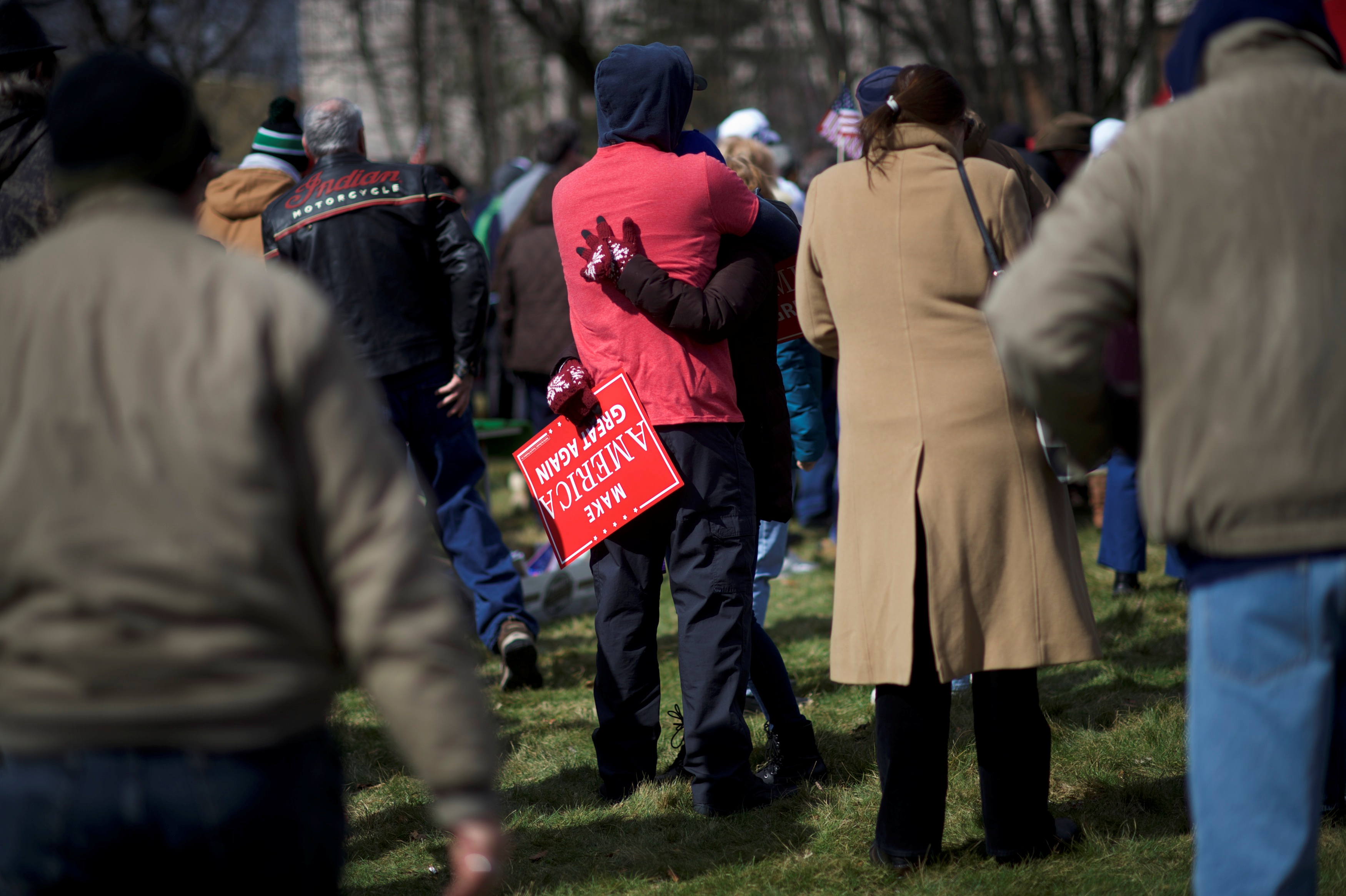 """Eric Falco, 32, embraces Alyssa Klingman, 23, while holding a """"Make America Great Again"""" sign during a """"People 4 Trump"""" rally at Neshaminy State Park in Bensalem"""