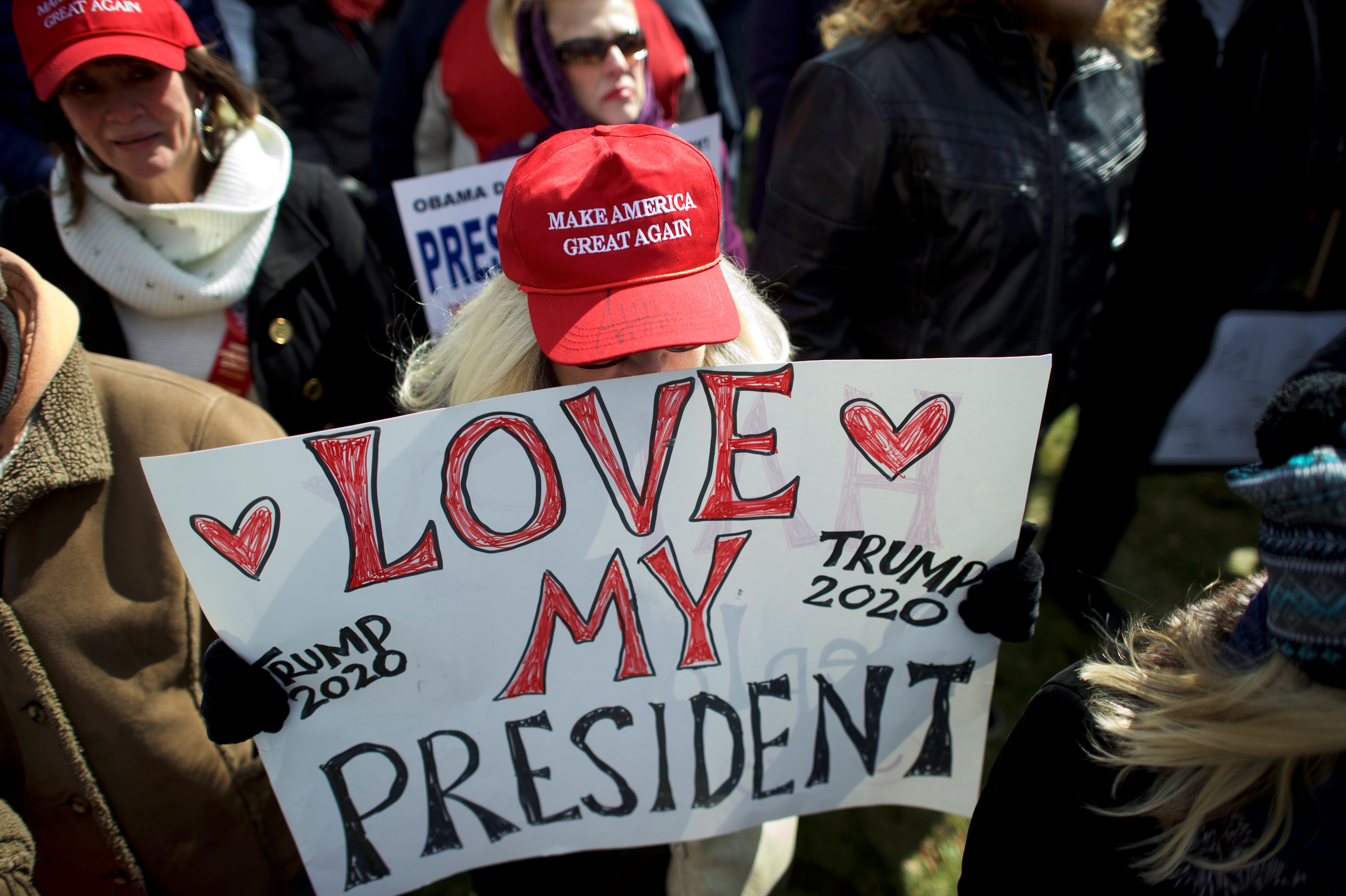 """Betsy Grosskopf wears an autographed hat by President Donald Trump during a """"People 4 Trump"""" rally at Neshaminy State Park in Bensalem"""