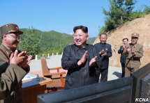 """Kim Jong Un arrives at the launch site to provide """"field guidance."""" (Photo credit: KCNA)"""