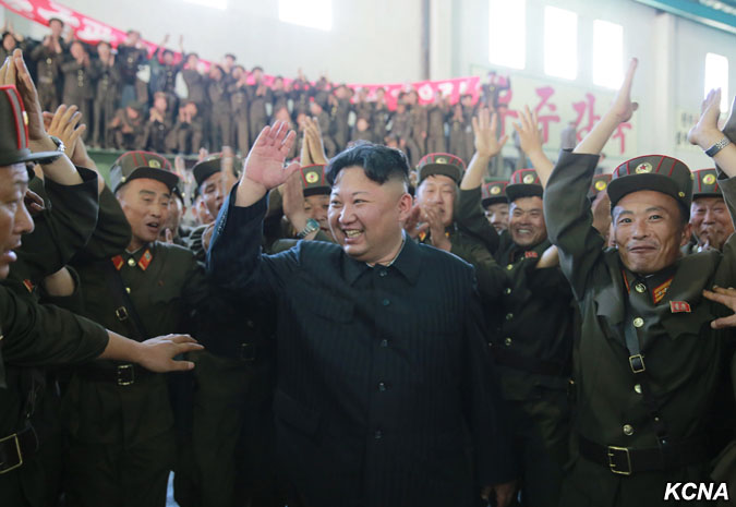 Kim Jong Un celebrates the successful test of a Hwasong-14 missile. (Photo credit: KCNA)