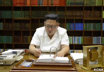 Kim Jong Un signs the order for the July 28 test launch. (Photo credit: KCNA)